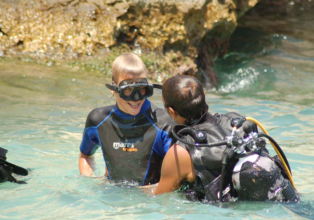 A sea baptism with a Cetaria diving instructor in Scopello